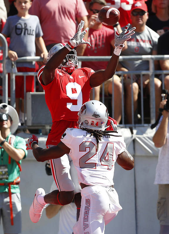Sep 23, 2017; Columbus, OH, USA; Ohio State Buckeyes wide receiver Binjimen Victor (9) catches the ball over UNLV Rebels defensive back Robert Jackson (24) for a touchdown during the second quarte ...