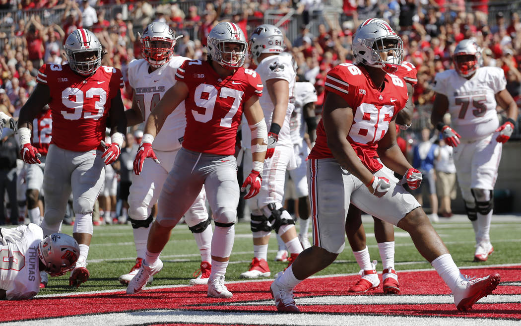Ohio State defensive lineman Dre'Mont Jones, right, celebrates tackling UNLV running back Lexington Thomas, left, for a safety during the first half of an NCAA college football game Saturday, Sept ...