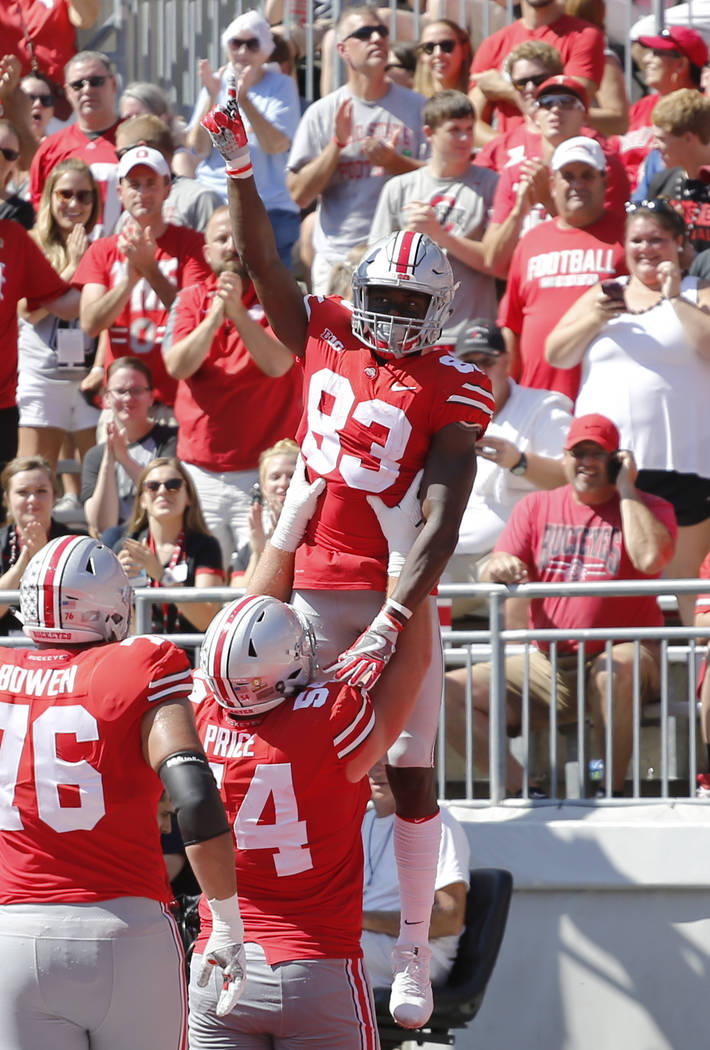 Ohio State receiver Terry McLaurin, top, celebrates his touchdown against UNLV during the first half of an NCAA college football game Saturday, Sept. 23, 2017, in Columbus, Ohio. (AP Photo/Jay LaP ...