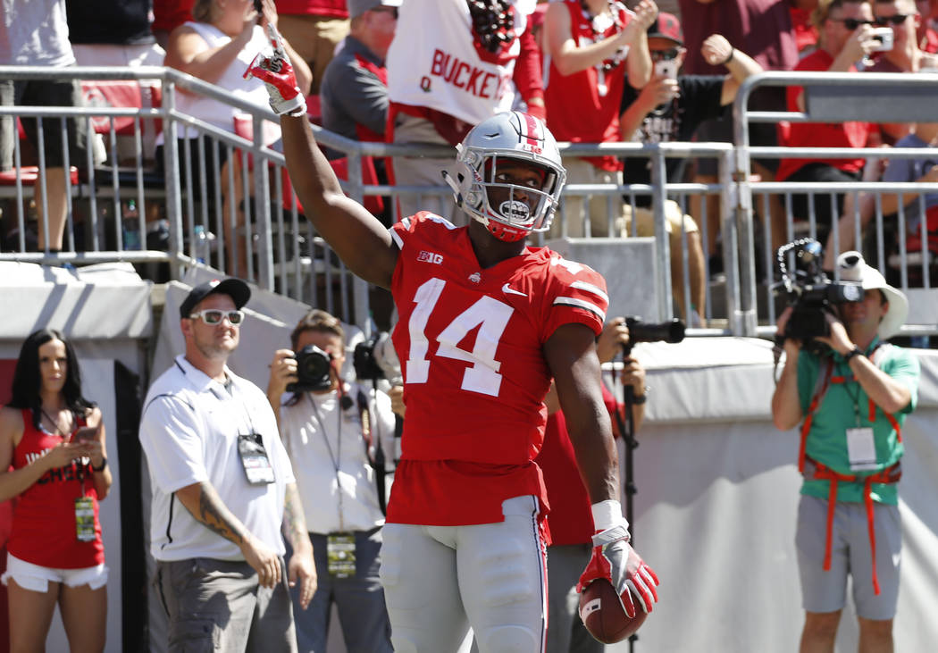 Ohio State receiver K.J. Hill celebrates his touchdown against UNLV during the first half of an NCAA college football game Saturday, Sept. 23, 2017, in Columbus, Ohio. (AP Photo/Jay LaPrete)