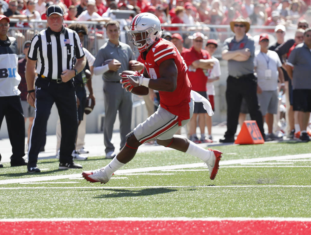 Ohio State receiver K.J. Hill scores a touchdown against UNLV during the first half of an NCAA college football game Saturday, Sept. 23, 2017, in Columbus, Ohio. (AP Photo/Jay LaPrete)