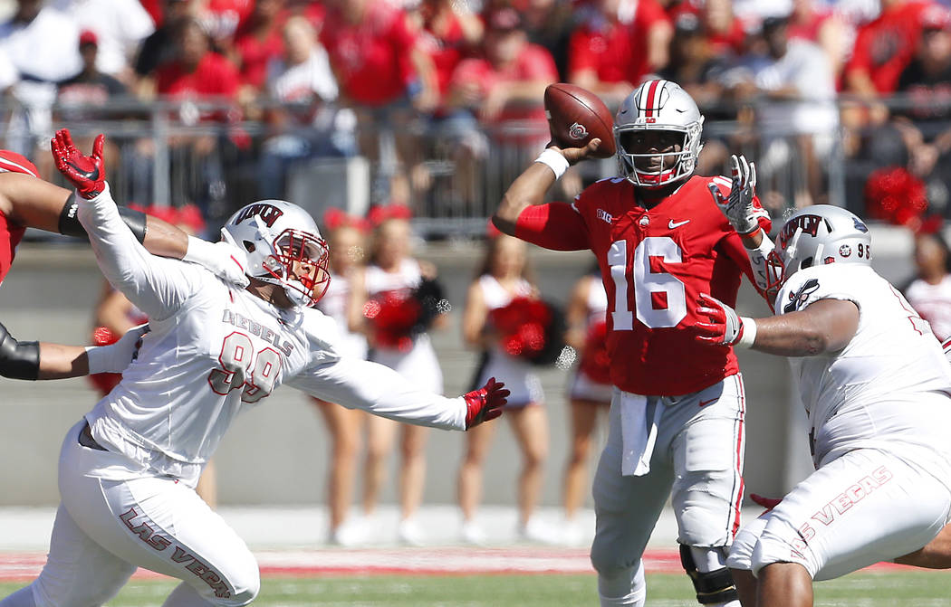 Sep 23, 2017; Columbus, OH, USA; Ohio State Buckeyes quarterback J.T. Barrett (16) throws the ball during the first quarter against the UNLV Rebels at Ohio Stadium. Mandatory Credit: Joe Maiorana- ...