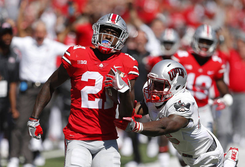 Sep 23, 2017; Columbus, OH, USA; Ohio State Buckeyes wide receiver Parris Campbell (21) carries the ball past UNLV Rebels linebacker Gabe McCoy (25) during the first quarter at Ohio Stadium. Manda ...