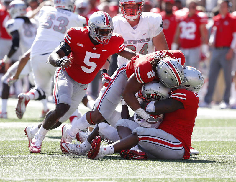 Sep 23, 2017; Columbus, OH, USA; UNLV Rebels wide receiver Jeremy Clark (18) is tackled by Ohio State Buckeyes defensive end Chase Young (2), Baron Browning (5) and defensive tackle Jashon Cornell ...