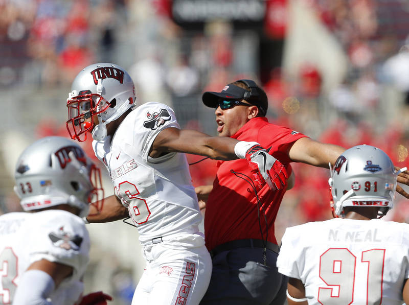 Sep 23, 2017; Columbus, OH, USA; UNLV Rebels linebacker Javin White (16) celebrates a fumble recovery with a member of the coaching staff during the fourth quarter against the Ohio State Buckeyes  ...