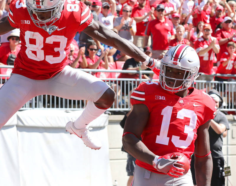 Sep 23, 2017; Columbus, OH, USA; Ohio State Buckeyes tight end Rashod Berry (13) runs past UNLV Rebels for the score as Buckeyes wide receiver Terry McLaurin (83) celebrates during the fourth quar ...