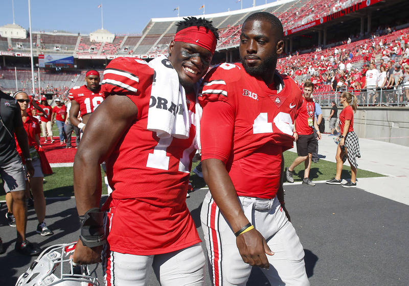Sep 23, 2017; Columbus, OH, USA; Ohio State Buckeyes linebacker Jerome Baker (17) and Ohio State Buckeyes quarterback J.T. Barrett (16) have some laughs after the game against the UNLV Rebels at O ...