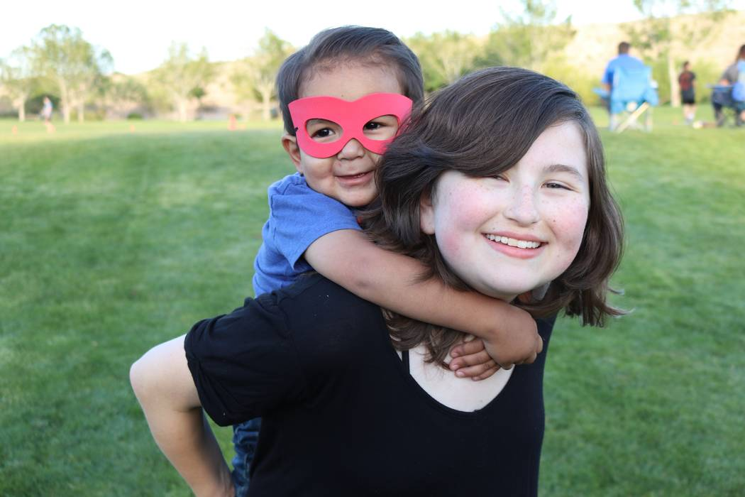 Show support for this year's Superhero Ambassadors Benji Sanchez, 3, and Kaila Elder, 13, and other kids battling cancer during the Candlelighters Superhero 5K at Mountain's Edge on Sept. 9. ( ...