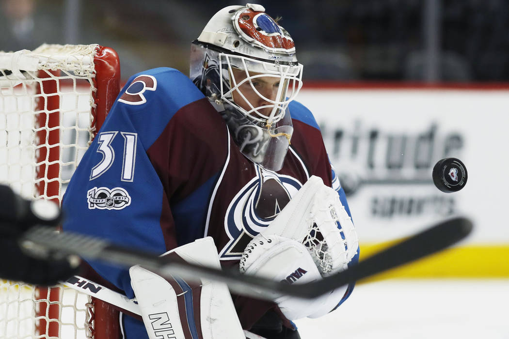 Colorado Avalanche goalie Calvin Pickard watches the puck bounce off his chest after stopping a shot against the Chicago Blackhawks in the second period of an NHL hockey game Tuesday, April 4, 201 ...