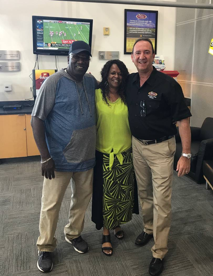 Chapman Automotive Don Hamrick, general manager of Chapman Dodge Chrysler Jeep Ram, poses with longtime customers Sam and Barbara Bowie. The couple bought a new Chrysler 300C to celebrate Barbara  ...