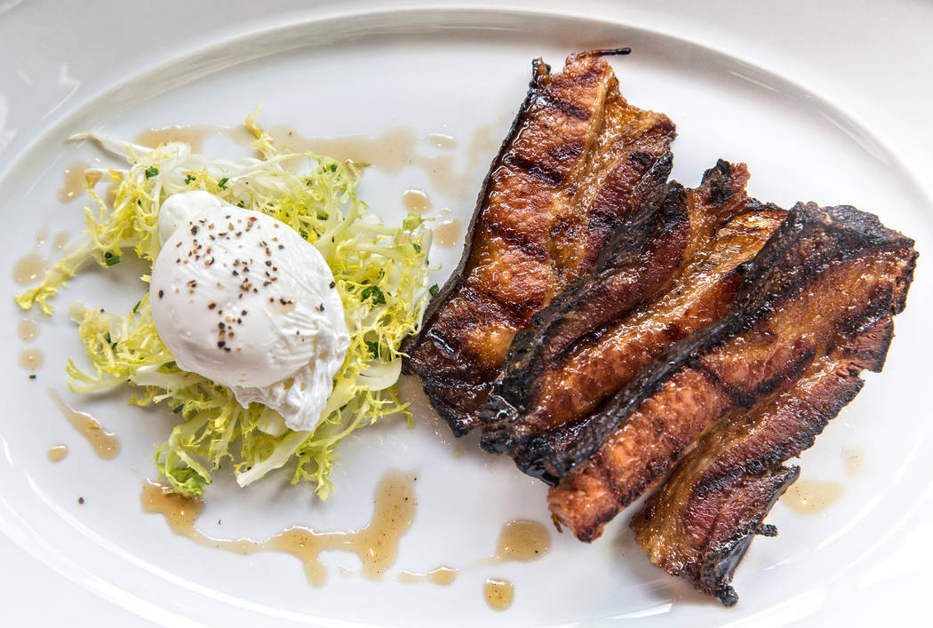 Grilled maple glazed bacon with a poached egg at MB Steak on Thursday, Aug 31, 2017, at the Hard Rock hotel-casino, in Las Vegas. Benjamin Hager Las Vegas Review-Journal @benjaminhphoto