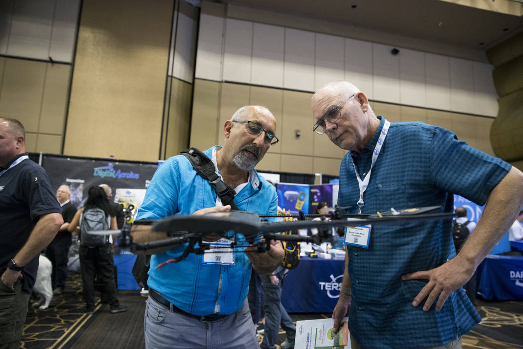 Jacob Apkarian, left, CEO of Coriolis, gives a demonstration to Michael Crider during the InterDrone conference at the Rio Convention Center in Las Vegas, Wednesday, Sept. 6, 2017. Erik Verduzco/L ...