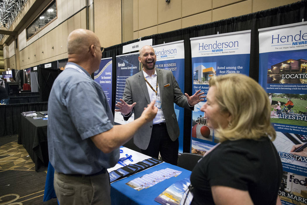 Kenneth Chapa, center, economic development officer for the City of Henderson, speaks to people during the InterDrone conference at the Rio Convention Center in Las Vegas, Wednesday, Sept. 6, 2017 ...