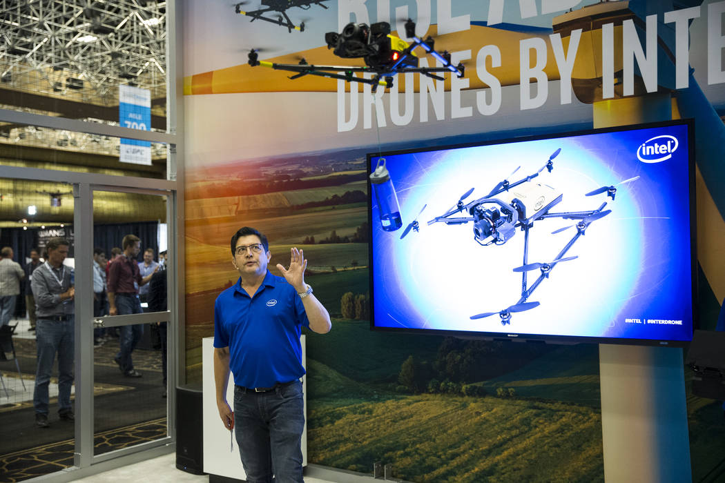 Jeffrey Lo, marketing manager for Intel, gives a demonstration of the Intel Falcon 8+ drone during the InterDrone conference at the Rio Convention Center in Las Vegas, Wednesday, Sept. 6, 2017. Er ...