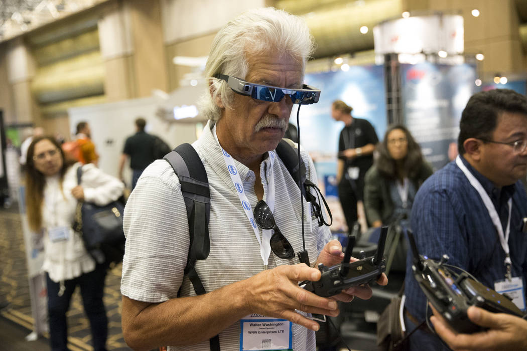 Walter Washington tests the Epson Moverio Augmented Reality Smart Glasses during the InterDrone conference at the Rio Convention Center in Las Vegas, Wednesday, Sept. 6, 2017. Erik Verduzco/Las Ve ...