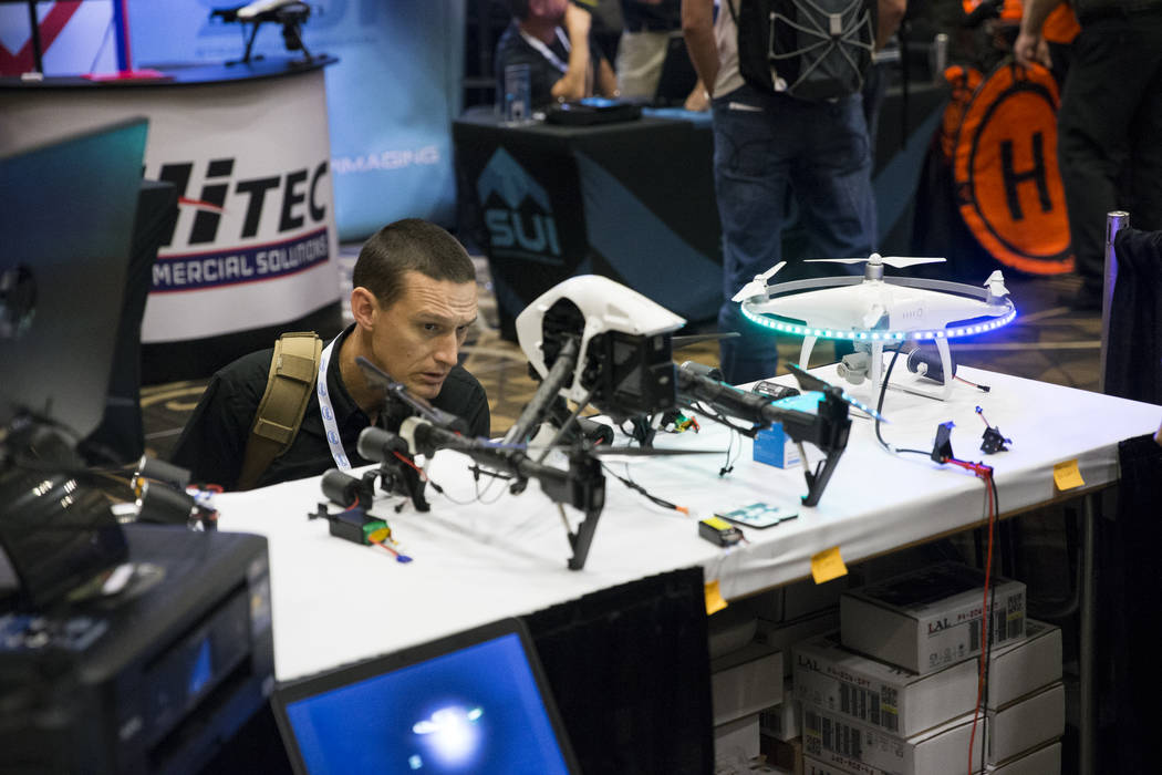 Clive Fennelow, technical support officer for the Royal Canadian Mounted Police, checks out LED lights for drones during the InterDrone conference at the Rio Convention Center in Las Vegas, Wednes ...