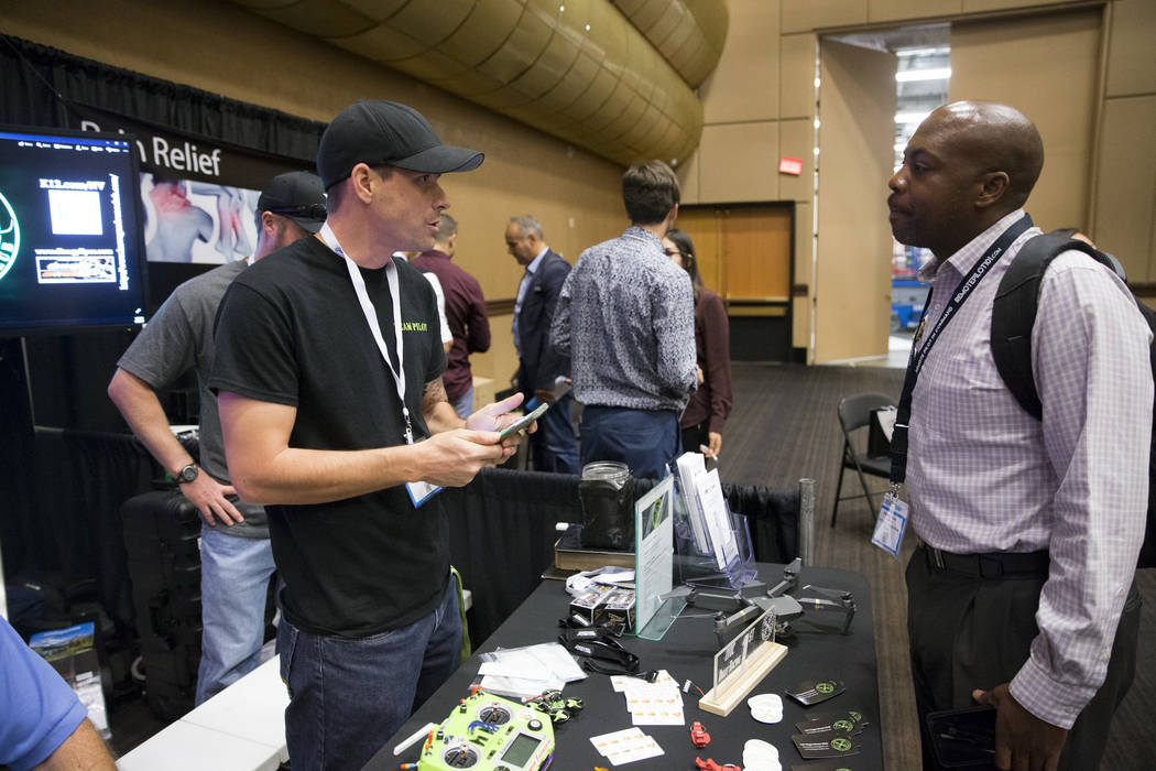 Exhibitor Chris Cernuto, left, founder of the Las Vegas Drone Club, speaks with Shawn Gibson, during the InterDrone conference at the Rio Convention Center in Las Vegas, Wednesday, Sept. 6, 2017.  ...