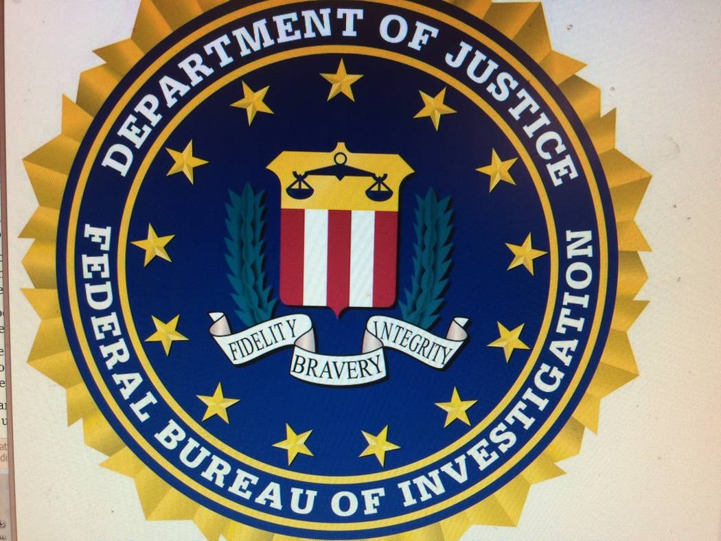 The insignia for the Federal Bureau of Investigation is seen on a computer screen. Scammers will sometimes use official symbols on their phishing emails then tell them that the FBI is after them.  ...