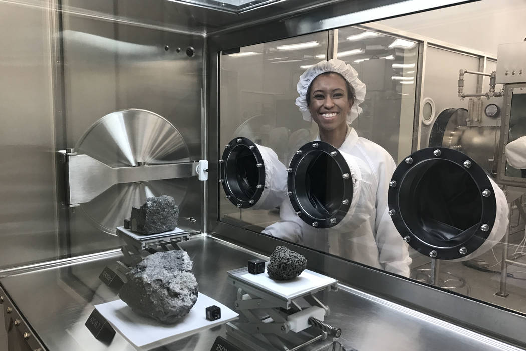 Amber Turner is suited up to avoid contamination April 14, 2017, at Lyndon B. Johnson Space Center. The UNLV students spent her spring semester there as an intern, working on unlocking the secrets ...