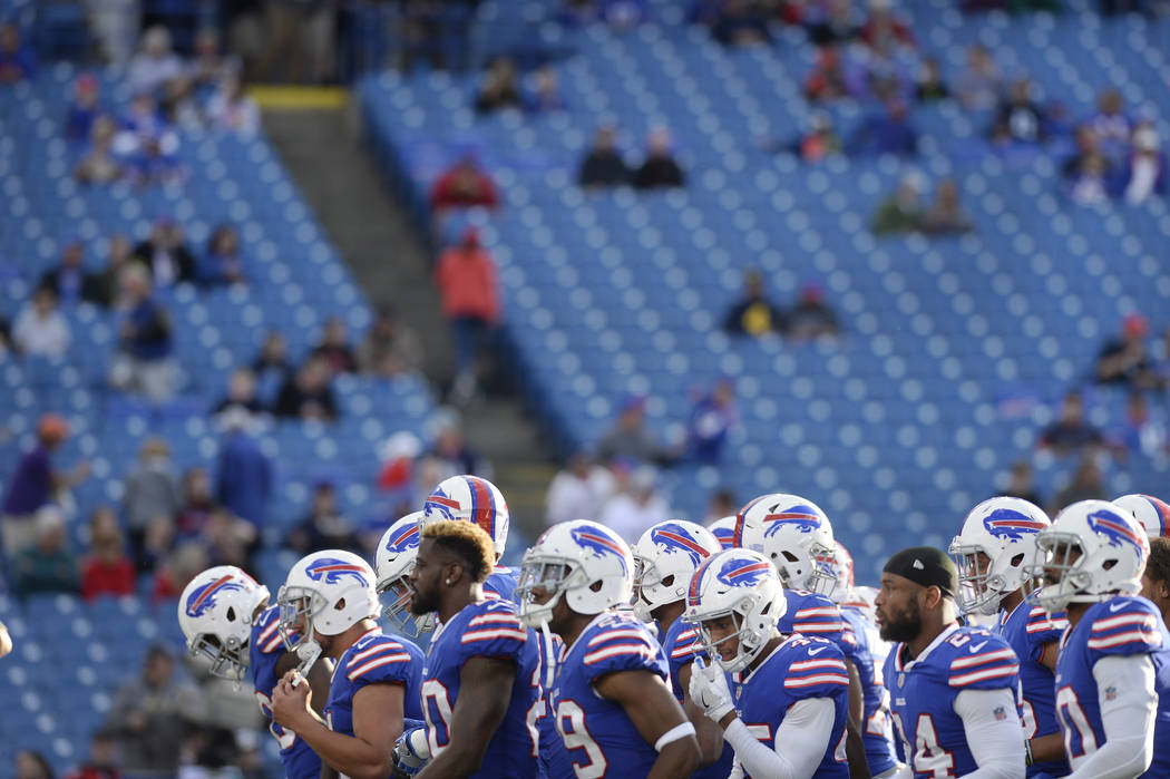 The Buffalo Bills take the field during the first half of a preseason NFL football game against the Detroit Lions Thursday, Aug. 31, 2017, in Orchard Park, N.Y. (AP Photo/Adrian Kraus)
