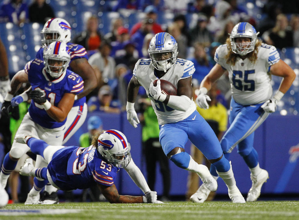 Detroit Lions' Adairius Barnes (38) runs for a touchdown during the second half of a preseason NFL football game against the Buffalo Bills Thursday, Aug. 31, 2017, in Orchard Park, N.Y. (AP Photo/ ...