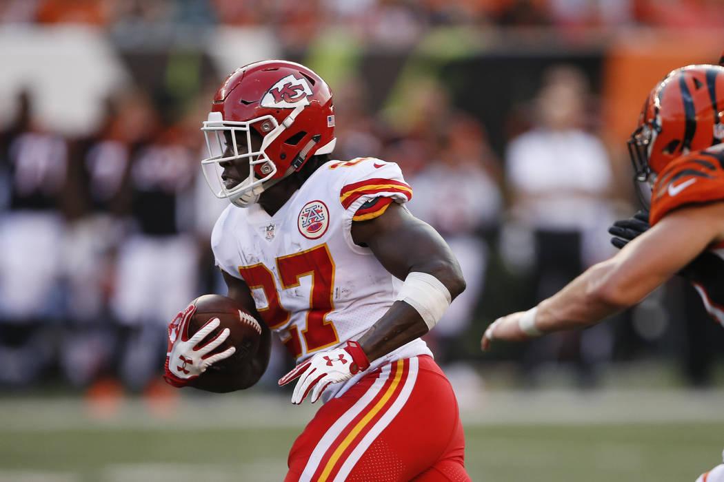Kansas City Chiefs running back Kareem Hunt (27) runs the ball in the first half of an NFL preseason football game against the Cincinnati Bengals, Saturday, Aug. 19, 2017, in Cincinnati. (AP Photo ...