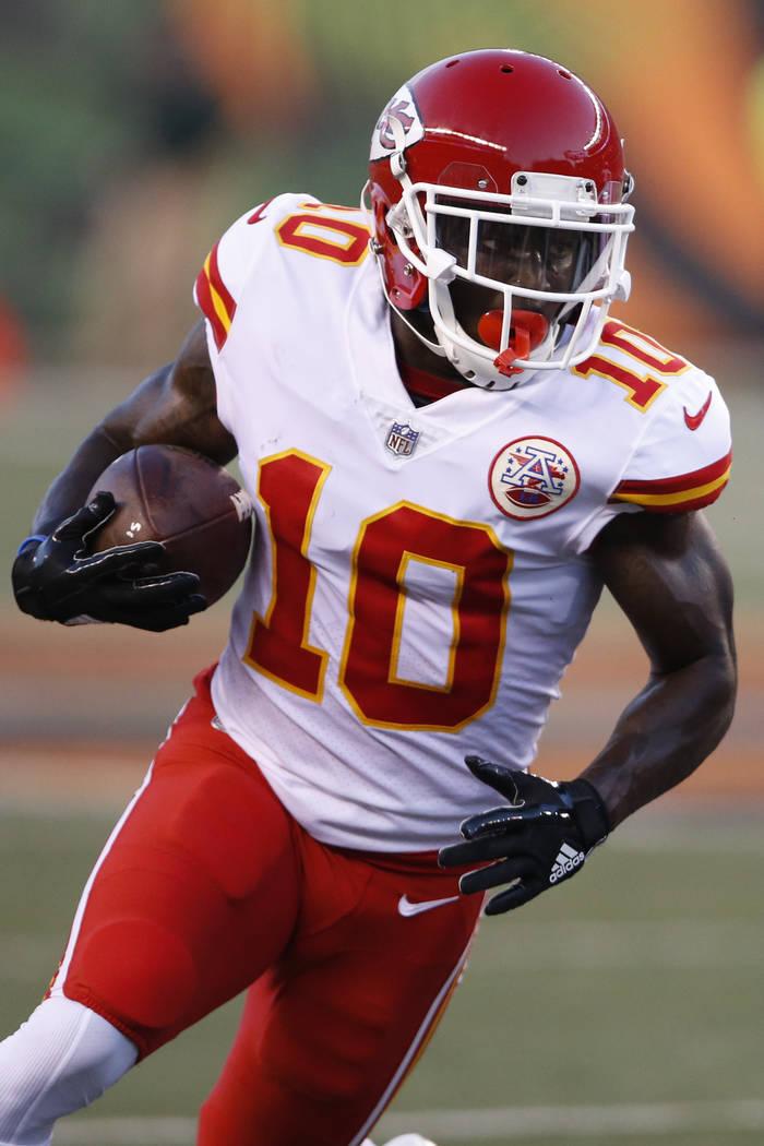 Kansas City Chiefs wide receiver Tyreek Hill runs the ball in the first half of an NFL preseason football game against the Cincinnati Bengals, Saturday, Aug. 19, 2017, in Cincinnati. (AP Photo/Gar ...