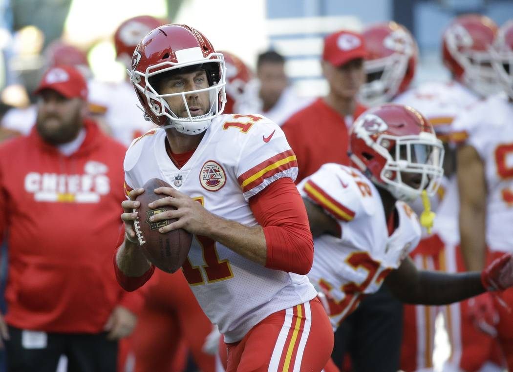 Kansas City Chiefs quarterback Alex Smith drops to pass during warmups before an NFL football preseason game against the Seattle Seahawks, Friday, Aug. 25, 2017, in Seattle. (AP Photo/Elaine Thompson)