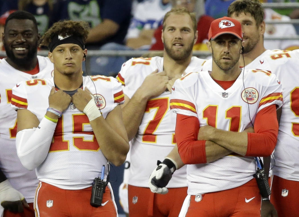In this Aug. 25, 2017, file photo, Kansas City Chiefs quarterback quarterback Alex Smith, right, stands on the sideline with backup quarterback Patrick Mahomes, left, in the second half of an NFL  ...