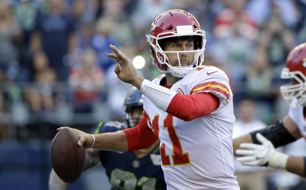 FILE - In this Aug. 25, 2017, file photo, Kansas City Chiefs quarterback Alex Smith prepares to throw against the Seattle Seahawks in the first half of an NFL football preseason game in Seattle. T ...