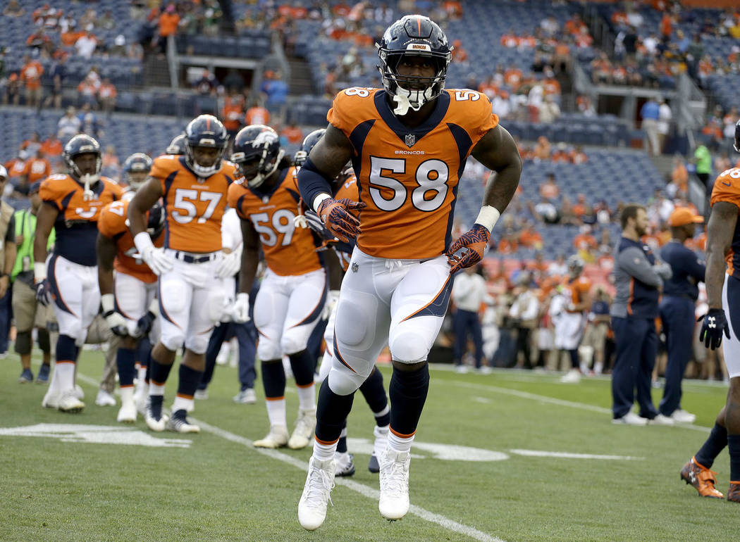 Denver Broncos outside linebacker Von Miller (58) warms up prior to an NFL preseason football game against the Green Bay Packers, Saturday, Aug. 26, 2017, in Denver. AP Photo/Jack Dempsey)