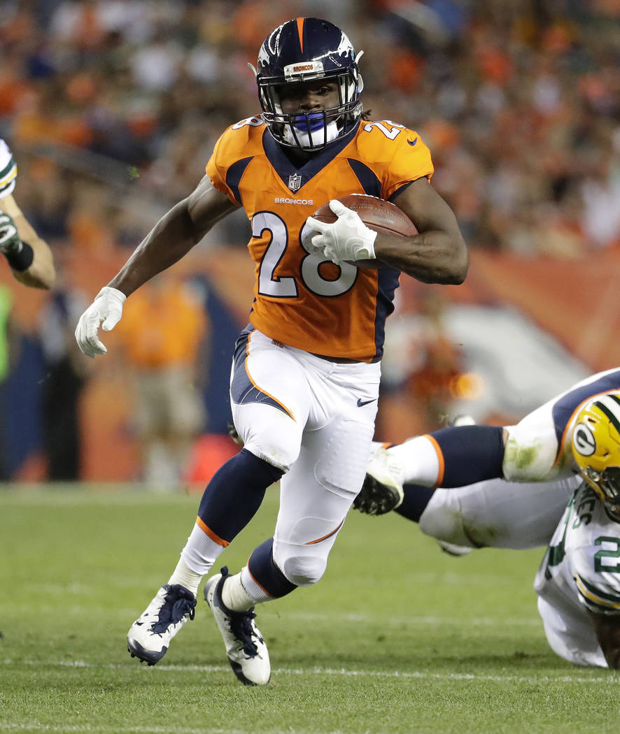 File-THis Aug. 26, 2017, file photo shows Denver Broncos running back Jamaal Charles (28) running against the Green Bay Packers during the first half of an NFL preseason football game in Denver.   ...