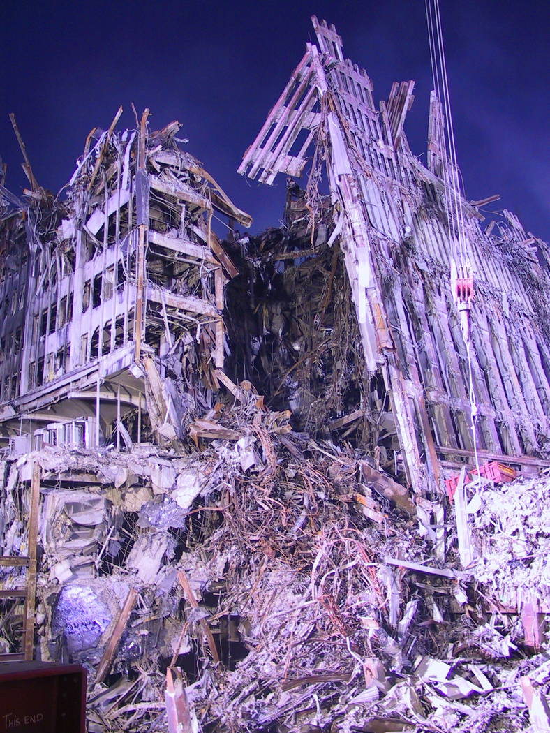 This October 11, 2001, photo shows crater in World Trade Center 6  with north skin of  World Trade Center 1 leaning on it. Photo by Duane Matters