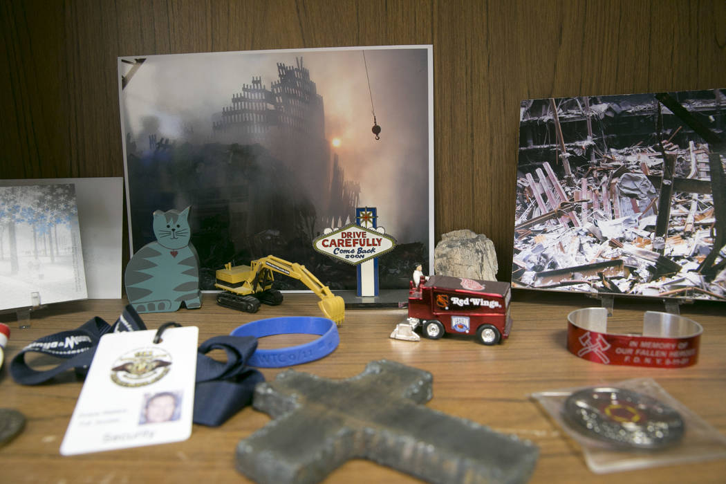 Photos Duane Matters shot as he was a member of the 9/11 emergency clean up crew, are displayed in his office in Las Vegas, Friday, Sept. 1, 2017.  Gabriella Angotti-Jones Las Vegas Review-Journal ...