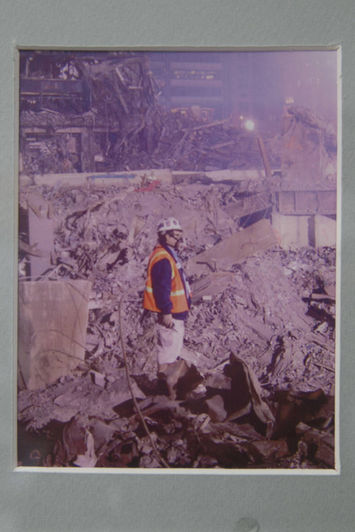A photo of Duane Matters, a Las Vegas local, in the rubble of the Twin Towers hangs on the wall of his office in Las Vegas, Friday, Sept. 1, 2017.  Gabriella Angotti-Jones Las Vegas Review-Journal ...