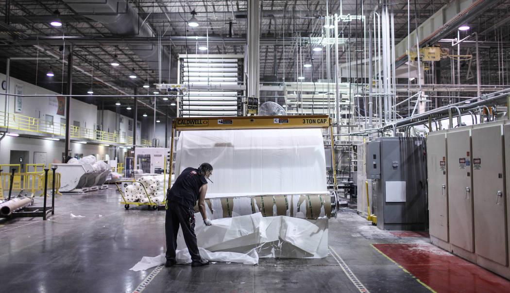 Scott Nilsen tears paper during a process at the Clearwater Paper plant in North Las Vegas, Thursday, Aug. 31, 2017. Joel Angel Juarez Las Vegas Review-Journal @jajuarezphoto