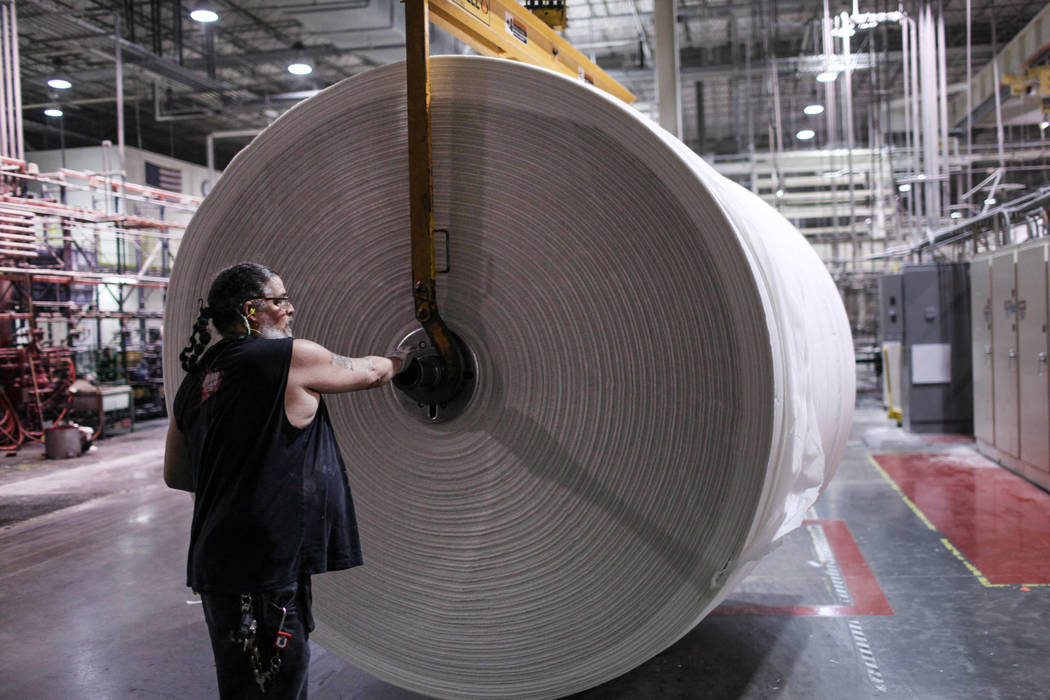 Scott Nilsen moves a roll of paper at the Clearwater Paper plant in North Las Vegas, Thursday, Aug. 31, 2017. Joel Angel Juarez Las Vegas Review-Journal @jajuarezphoto