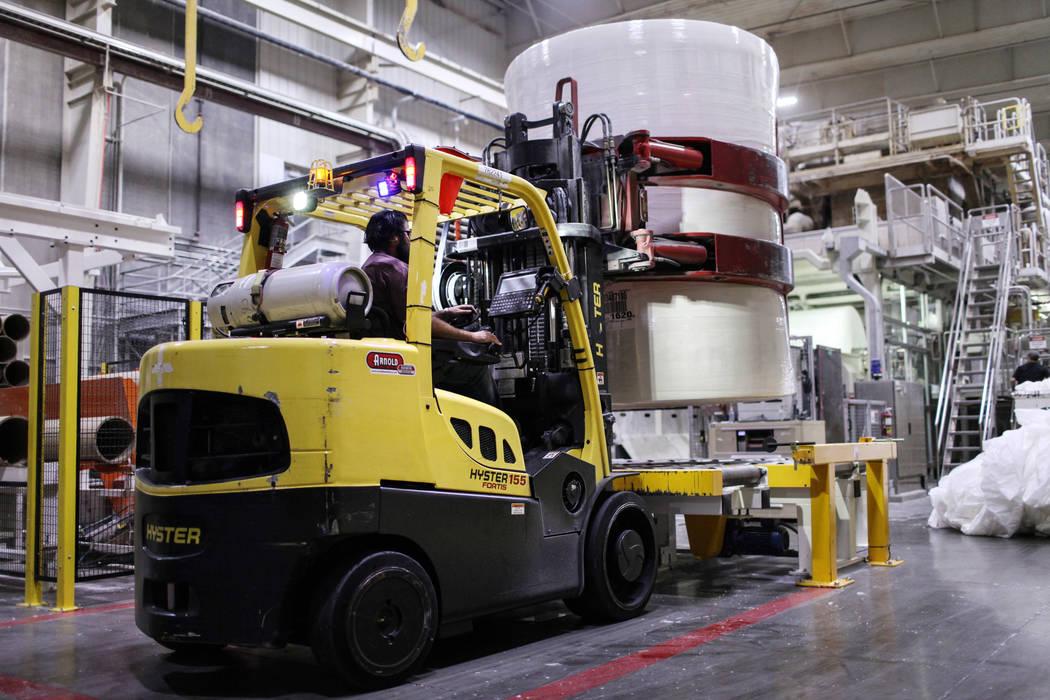 Doug Mecham transports a processed roll of paper at the Clearwater Paper plant in North Las Vegas, Thursday, Aug. 31, 2017. Joel Angel Juarez Las Vegas Review-Journal @jajuarezphoto
