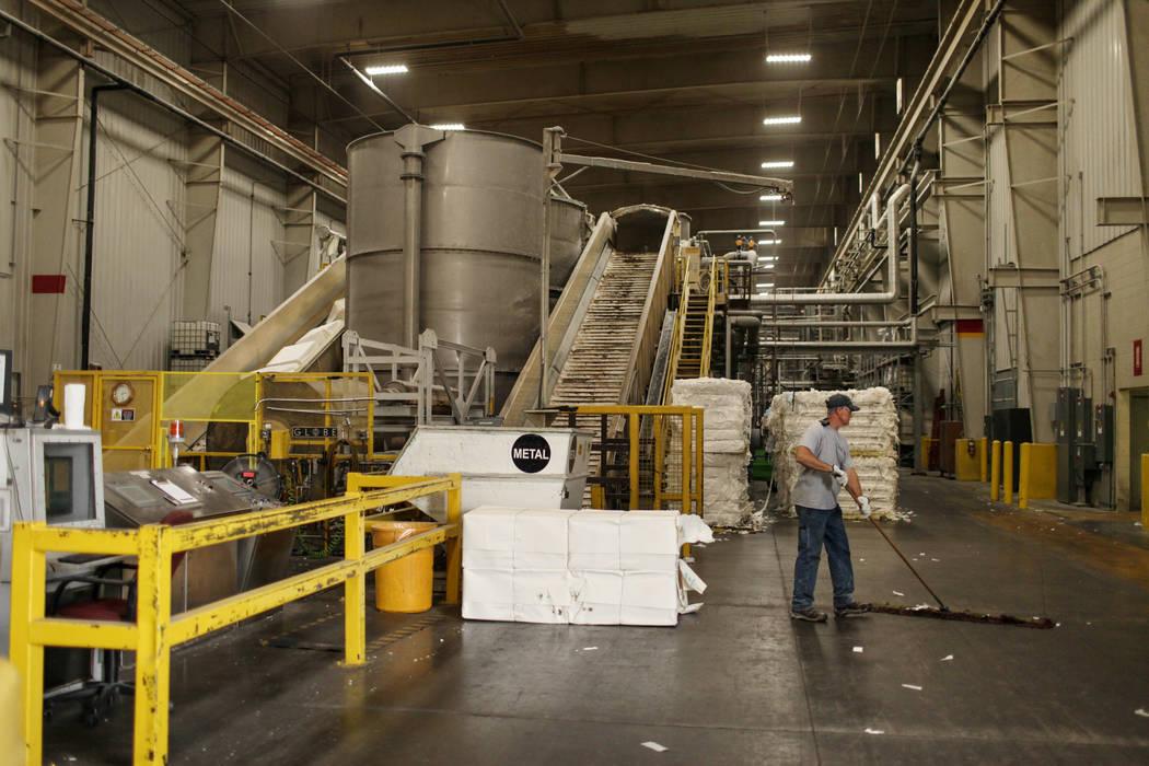 Dave Philbert sweeps his workstation at the Clearwater Paper plant in North Las Vegas, Thursday, Aug. 31, 2017. Joel Angel Juarez Las Vegas Review-Journal @jajuarezphoto