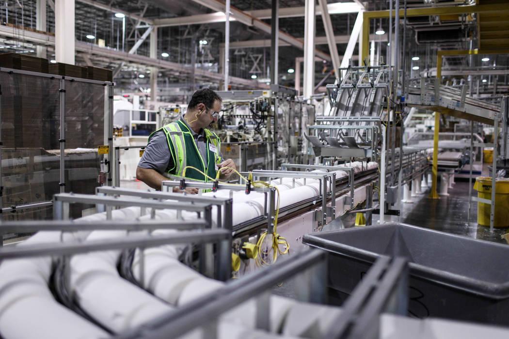 Plant Manager Sean Krajnik inspects cut rolls of tissue paper at the Clearwater Paper plant in North Las Vegas, Thursday, Aug. 31, 2017. Joel Angel Juarez Las Vegas Review-Journal @jajuarezphoto