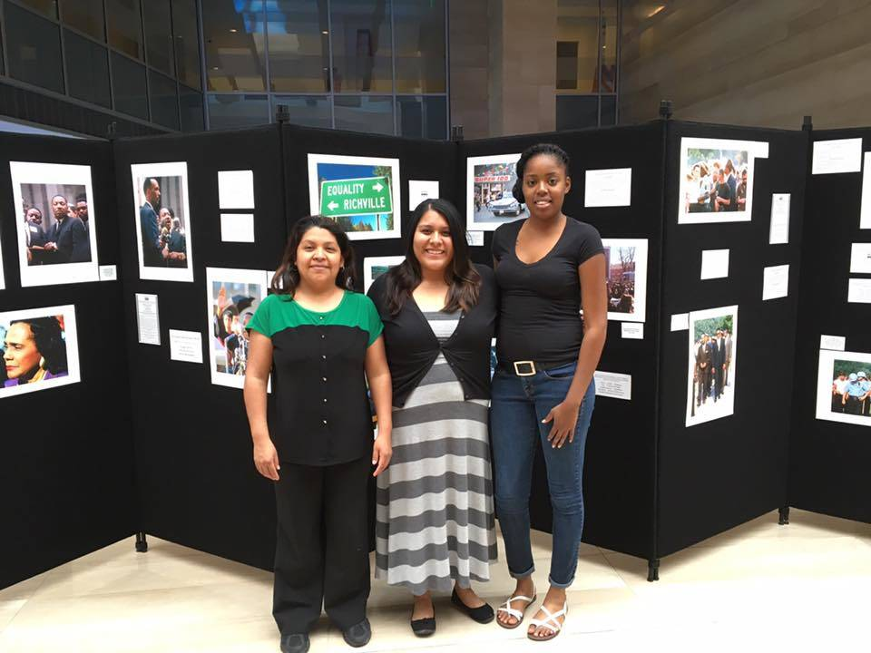 Silver State Fair Housing Council staff stands in front of a photo display on the Chicago Freedom Movement outside the City of Las Vegas Council Chambers in April. The Chicago movement was the fir ...