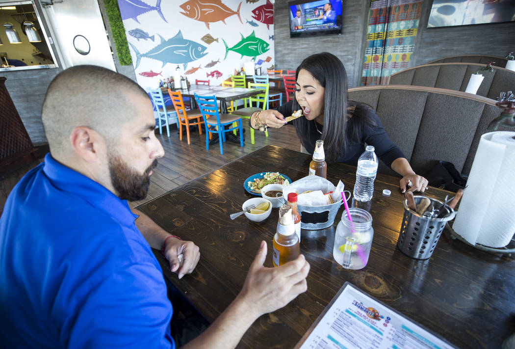 Eliazar Marin, left, and Delia Holguin have tostadas and beer for lunch at Cevicheria El Diamante located at 2457 East Tropicana Avenue on Monday, Sept. 11, 2017, in Las Vegas. Richard Brian Las V ...