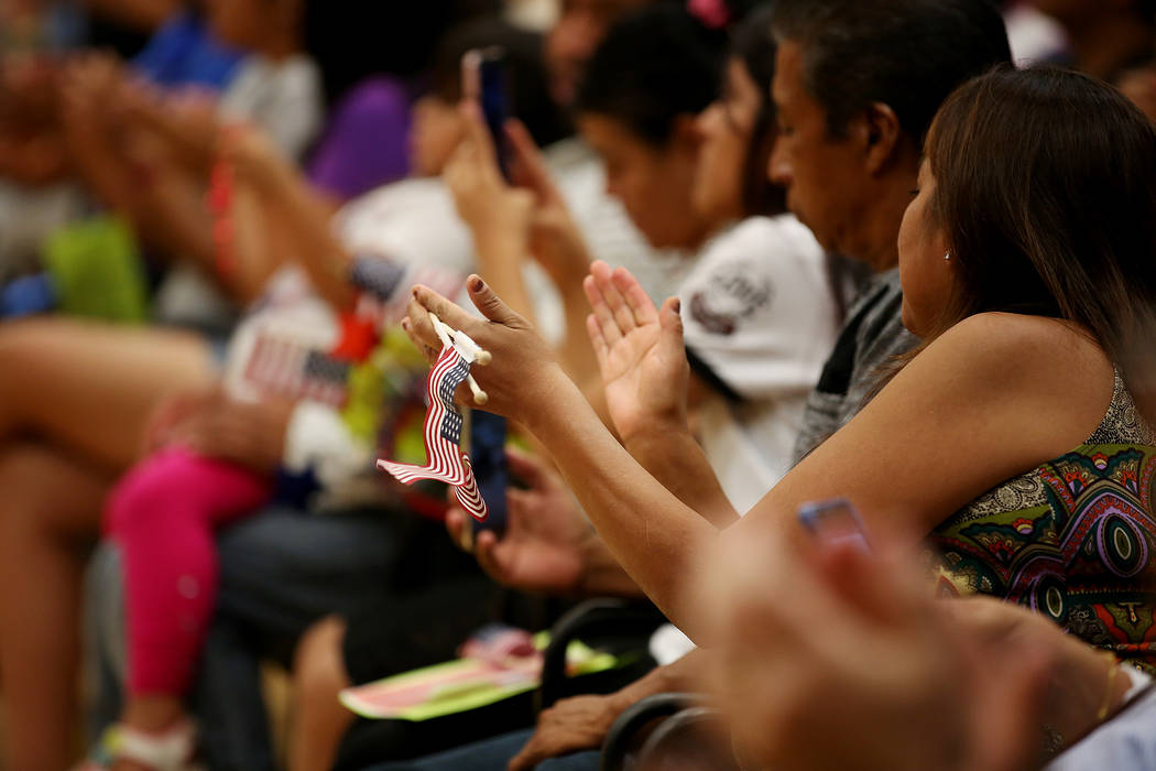 Attendees clap during an informative event on Deferred Action for Childhood Arrivals at East Las Vegas Community Center on Tuesday, Sept. 5, 2017. Bridget Bennett Las Vegas Review-Journal @bridget ...
