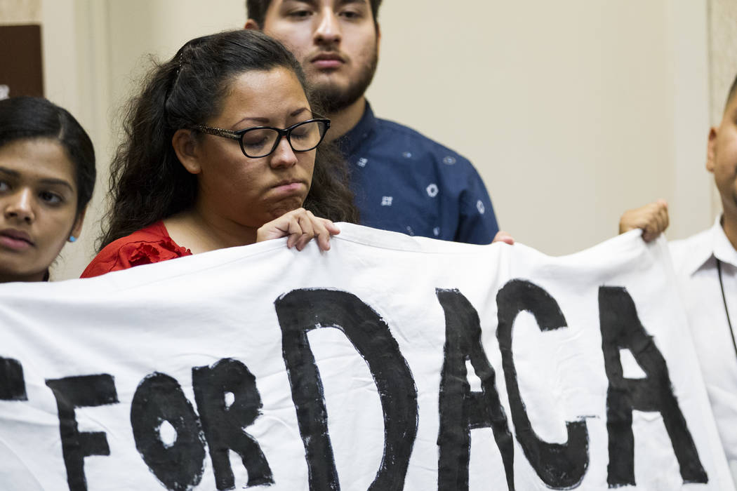 Katherine Lorenzo, from left, Kenia Morales, and Arturo Gonzales, supporters of the Deferred Action for Childhood Arrivals program, attend a press conference on the cancellation of DACA at the Eas ...