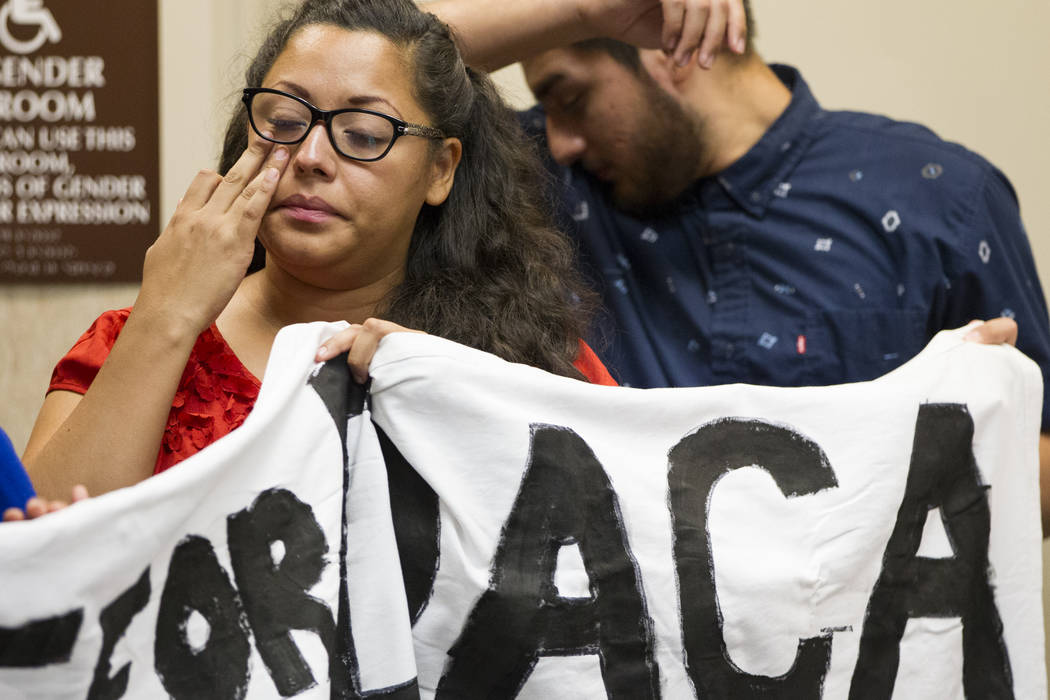 Kenia Morales, left, a supporter of the Deferred Action for Childhood Arrivals program, reacts during a press conference on the cancellation of DACA at the East Las Vegas Community Center, in Las  ...