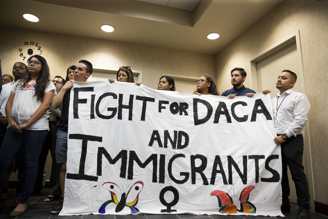 Supporters of the Deferred Action for Childhood Arrivals program attend a press conference on the cancellation of DACA at the East Las Vegas Community Center, in Las Vegas, Tuesday, Sept. 5, 2017. ...