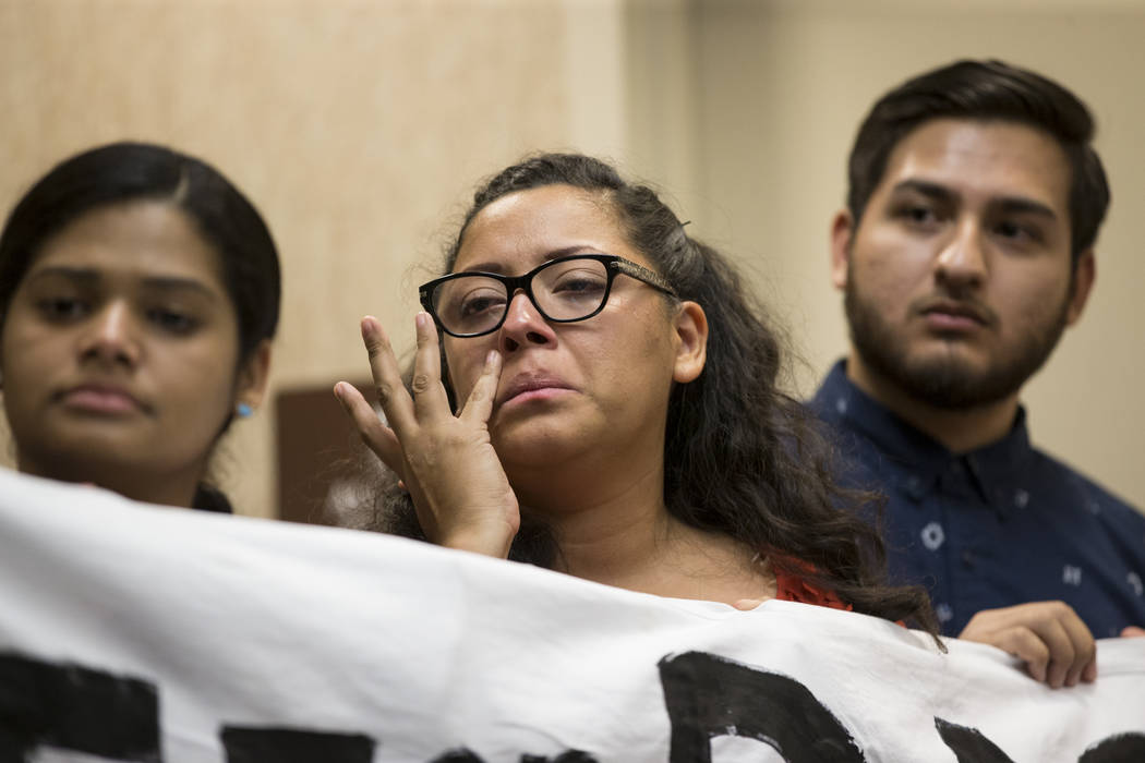 Kenia Morales, center, a supporter of the Deferred Action for Childhood Arrivals program, reacts during a press conference on the cancellation of DACA at the East Las Vegas Community Center, in La ...
