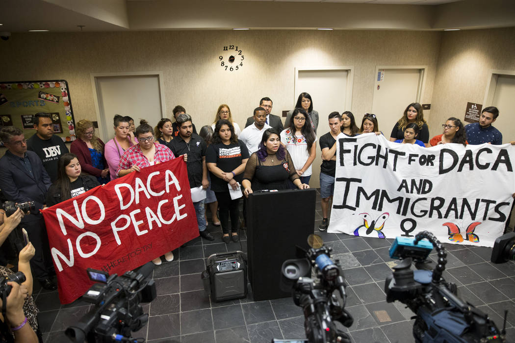 Local activist Astrid Silva and recipient of the Deferred Action for Childhood Arrivals program, reacts during a press conference on the cancellation of DACA at the East Las Vegas Community Center ...