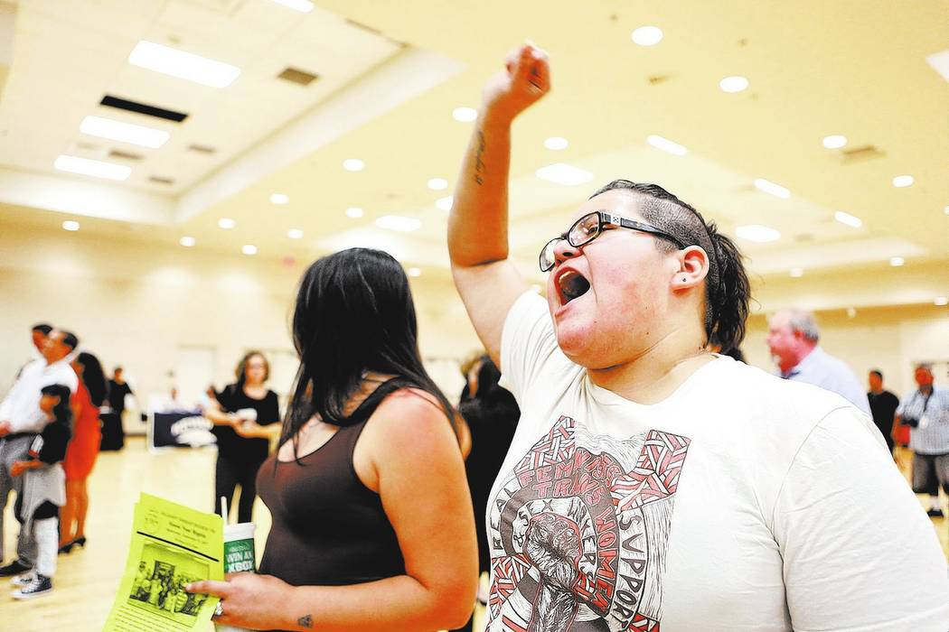 "Attendee and activist Yesenia Moya chants ""S, se puede"" with the crowd during an informative event on Deferred Action for Childhood Arrivals at East Las Vegas Community Center on ..."