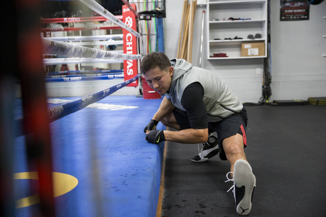 """Gennady Golovkin stretches during a workout at The Summit Gym in Big Bear, Calif., on Wednesday, July 26, 2017. Golovkin is training for his September 16 boxing bout against Saul """"Canelo& ..."""
